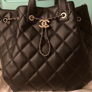 Brand new Chanel bucket purse with box and bow